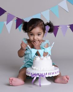 Sweet baby girl 1st birthday cake smash photos featuring a purple and turquoise theme | Photoworks | http://www.photosthatwork.com/cake-smash-toronto-baby-photo-session/ | info@photosthatwork.com | Toronto, Canada