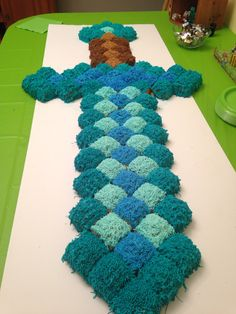Minecraft sword cake made with 84 square cupcakes.