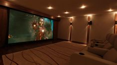 Basement home theater ideas, DIY, small spaces, budget, medium, inspiration, built ins, paint colors, garage, film reels, projects, wall art, projection screen, hardwood floors, tips and crown #hometheatertips #hometheaterdiy #diyhometheater