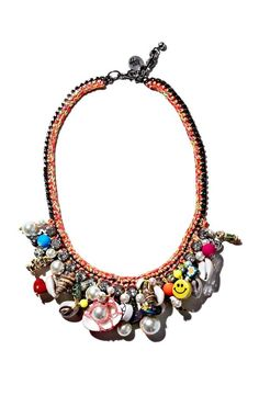 Beach vibe - Love the mix of bright beads, charms, stones and seashells on this necklace.