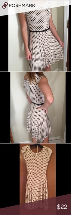 """GILLI A LINE SWING DRESS POLKADOT APPROX SIZE 3 This is a GILLI brand A line swing dress.  It looks to be a cotton knit.  Tag has been cut out.  It fits a size 2-3 as that is the models size.  It is CREAM with black polkadots.  A vintage style look.  I think it's a cute little spring/ summer dress.  In good pre owned condition. Flat waist measures 12"""" and stretches to 13 1/2"""". The chest measures 15 1/2"""" just below the under arm, total length is 35 1/2"""" in the front and 36"""" in the back…"""