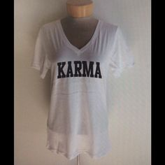 "KARMA white v neck White sheer cotton v neck ""KARMA"" printed on front ladies loose fit v neck. Size up for an oversized fit. . PLEASE SELECT SIZE and CHECK OUT with the buy it button Tops"