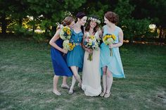 the more i think about it, the more i like the idea of mismatched bridesmaid dresses in the same color family