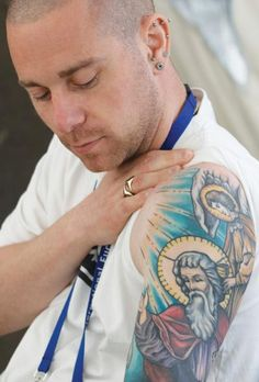 A tattoo of God the Father article about religious tatoos