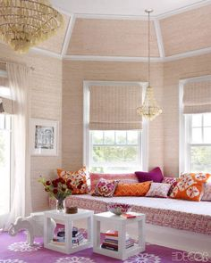 A banquette in the master bedroom is covered in a China Seas fabric, and the light fixtures are by Arteriors