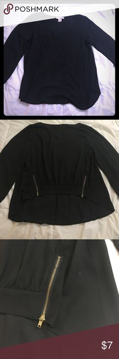 Long sleeve Black Flowy Top w/ Zipper Back This shirt is a different style in that the front comes down longer than the back and the back is banded at the waist with two gold zippers - absolutely adorable on and very comfortable! Sans Souci Tops Blouses