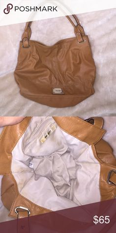 Used Nine West purse. Cognac color Used Nine West purse.. some small marks on it nothing bad still in good condition Nine West Bags Shoulder Bags