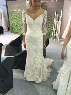Full length or 3/4 length sleeves available not this gorgeous love wedding dress with a low back and beaded lace appliqués. By Casablanca Bridal, available at The Bridal Lounge  Www.TheBridal-Lounge.co.uk