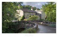 Pretty bridge and cottage at Kettlewell. Wharfedale, Yorkshire Dales National Park, England.