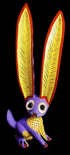 Alebrije conejo ojos de canica - Alebrijes are brightly colored Mexican folk art sculptures of fantastical creatures.