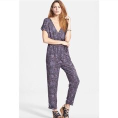"""SALE NWT Free People Universal Jumpsuit Night combo. Short sleeves, deep V-neck and back. Ties in the back. Drawstring elastic waistband. Straight leg with seamed cuffs. (Would probably look better on someone 5""""6 or taller. I'm 5'4 and 110 pounds and petite and feel like it's a little big/long.) Viscose material Inseam: 27 inches Machine washable Free People Pants Jumpsuits & Rompers"""