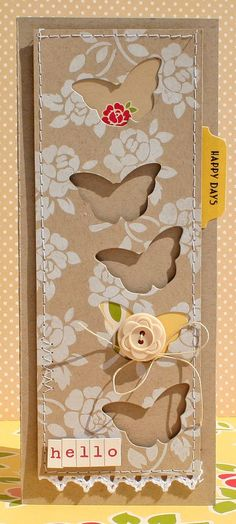 card by Danni Reid.... love the white, opaque stamping on kraft  and popped-up front panel with peek-a-boo butterfly windows!