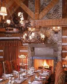 Dining room with a warm, cozy fireplace Dining Room Fireplace, Cozy Fireplace, Dining Rooms, Stone Fireplace Pictures, Stone Fireplace Designs, Rustic Charm, Rustic Decor, Light My Fire, Post And Beam