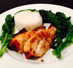 Broiled chicken marinated in soy sauce, lemongrass paste, garlic powder and pepper; with sautéed rapini and rice