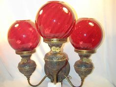Mouse over image to zoom    Have one to sell? Sell it yourself  PAIR Antique CRANBERRY GLASS SWIRL Wall Sconces electric kerosene triple globes