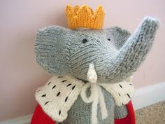 Babar stands 11 inches tall. He is knit in the round with worsted weight yarn, and in one piece from the neck down, so there is very little seaming required. The knitter has the option of making him with his trunk up or down; both versions are included in this pattern.