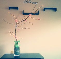 DIY cherry blossom tree  Supplies: Wire hangers & floral stem wrap Tissue paper scissors & stapler Vase & marbles battery posted led lights or Christmas lights