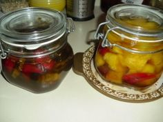 Hot peppers in honey and pineapple and very hot peppers in honey