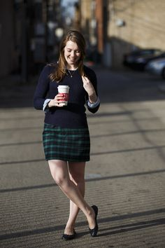 Layered chambray and navy cable knit sweater, green plaid skirt. Classic/ preppy fall outfit.