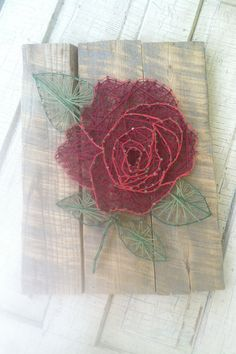 This particular piece is very heavy duty art. The reclaimed hardwood makes a beautiful backdrop to an intricate rose.