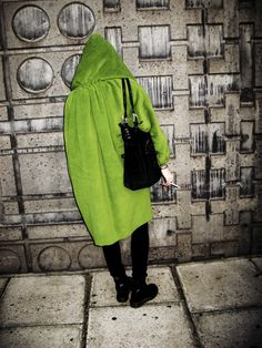 w green coat hood concrete wall  via wgsncolourarchive.tumblr.com