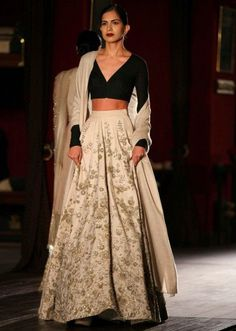 Sabyasachi- Model walking the ramp in cream anarkali with black choli for sabyasachi during Indian couture week July 2014 Indian Lehenga, South Indian Sarees, Lehenga Designs, Indian Attire, Indian Ethnic Wear, Indische Sarees, Indian Wedding Wear, Bride Indian, Modern Saree
