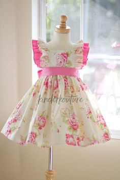The Creamy Vintage Rose dress is a classic girls handmade dress made by Kinder Kouture Clothing. This vintage style inspired pattern is full of beautiful details such as flutter sleeves, a solid pink