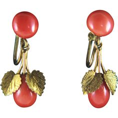 A pair of red coral suspending screw back earrings. Each earring has a round coral bead on the top, about 9mm in diameter, suspended with two leaves