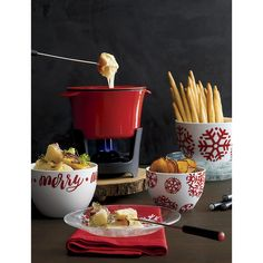 Shop Cast Iron Fondue Set. Inspired by the '70s fondue craze, this all-purpose fondue pot is crafted of cast iron with red enameled exterior and white enameled interior.