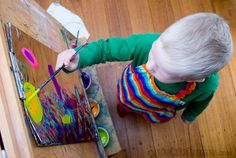 This is a super fun, super easy, art activity, with one magic trick to make the paint stick!