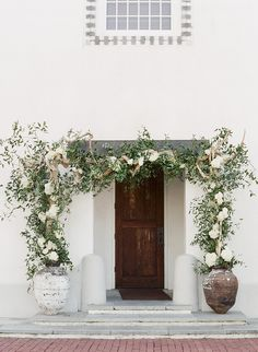 Beach Wedding Photos Rosemary Beach Wedding, flower entrance to Rosemary Town Hall, white hydrangea, white roses. Floral design by Nouveau. Amsale Bridesmaid, Grand Floridian Disney, Rosemary Beach, Seaside Wedding, Destination Wedding, White Roses, Hydrangea, Outdoor Gardens, Floral Arrangements