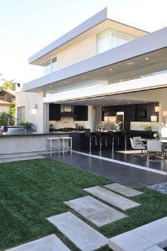 Contemporary Family Home Literally Opening Towards Its Backyard Garden