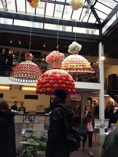 Handmade pom-pom chandeliers captured by stylist @Annette Joseph in Paris at Merci.
