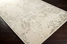 Beautiful antique white rug with caper green accents