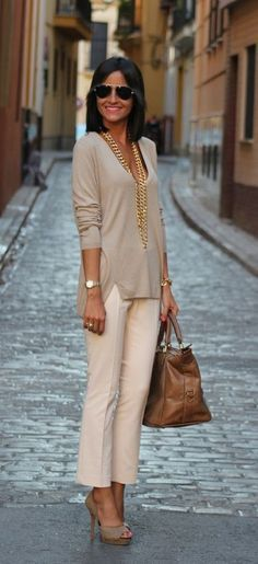 such a classy outfit (although the cleavage takes away from the classines)