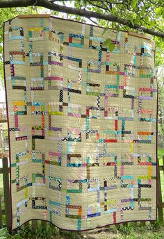 Love the tea-stained beige color in the background.  midwest metro link quilt from teaginny   Flickr