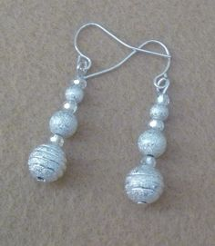 "1.5"" silver French hook earrings with stardust silver balls (4, 6, and 8mm) and 3mm clear AB Swarovski beads between the silver ball beads.  SALE $16.80  Fall Sale 20% off all items and Free shipping in US at:  GemsAndCrystalsEtc.ArtFire.com"