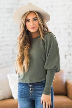 We are absolutely in love with our new Maryana Bubble Sleeve Top! Our top is so soft and fits like a dream! From the cinched ribbed texture, to the bubble long sleeves, our top is a must-have this season! Our tunic is so cozy and soft making it the perfect choice for everyone's wardrobe this season! Rock this with your favorite skinnies and heeled booties for a comfy, yet sophisticated look!