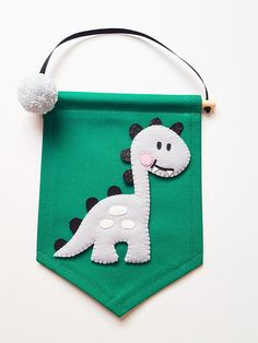 Dinosaur bannner, emerald green background (Colours can be customised) Felt Crafts Diy, New Crafts, Baby Crafts, Creative Crafts, Crafts For Kids, Baby Door Decorations, Baby Decor, Hanging Banner, Felt Embroidery