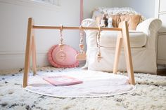 Modern Monty wooden play gym in pink and white little girl's nursery. This modern, minimalist toy suits any nursery style!