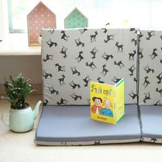 A perfect reading spot  Our Bambi play mat can be folded even to a sofa
