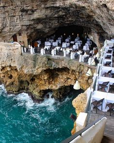 The Grotta Palazzese Summer Restaurant and it's located in a hotel by the same name in Polignano a Mare in the Puglia region of Southern Italy. Vacation Places, Italy Vacation, Dream Vacations, Vacation Spots, Places To Travel, Places To See, Travel Destinations, Holiday Destinations, Vacation Packages