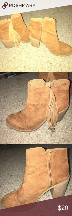 Burnt orange/brown booties Size 9 will fit 8.5 burnt orange brownish colored booties with fringe on outside of bootie. Perfect for dresses or jeans. The fringe gives a little extra pop. The toe of the booties have a little wear but nothing that can be seen from a 2 foot radius. I'm wearing them in last photo. Shoes Ankle Boots & Booties