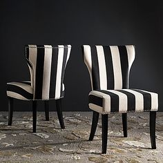 Safavieh Jappic 22 H Side Chair's slightly curved and tapered backrest are made for drama. Shown in black and white-colored fabric and espresso finish on legs, exposed nail heads add a classic touch to Jappic.