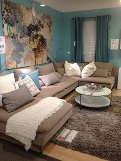 Ikea living room; teal, creams and mellow accents.