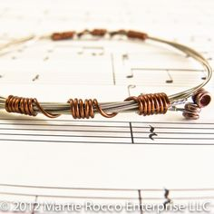 Guitar string bangle bracelet with brown wire wrap. GS12-66