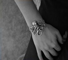 Olivia Paige -Rockabilly octopus bracelet by OliviaPaigeClothing on Etsy https://www.etsy.com/listing/179928513/olivia-paige-rockabilly-octopus-bracelet