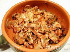 Mushrooms in tomato sauce in a pan