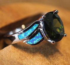 Exquisite elegant fire opal and topaz ring size 8 Please view item photos closely & do zoom in, for better viewing the details . The depth of colo