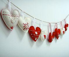 Felt Scandinavian red & white heart christmas ornaments via Etsy - they look pretty easy to make.